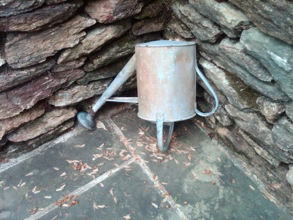 Upended Watering Can