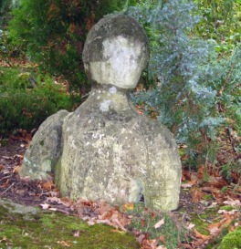 Stone Man Emerging from Ground