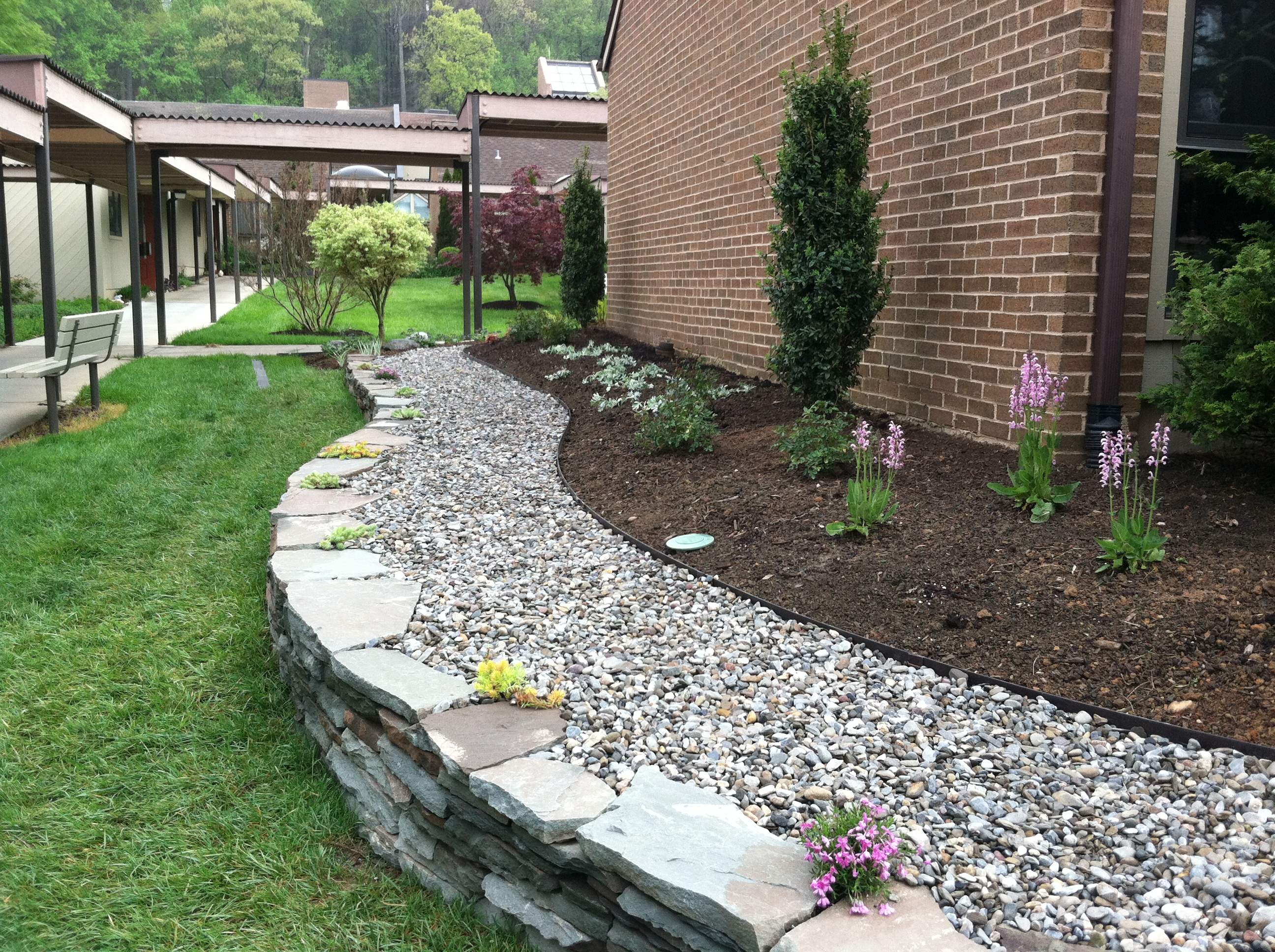 Innovative garden design of a small property the garden for Rock landscaping ideas
