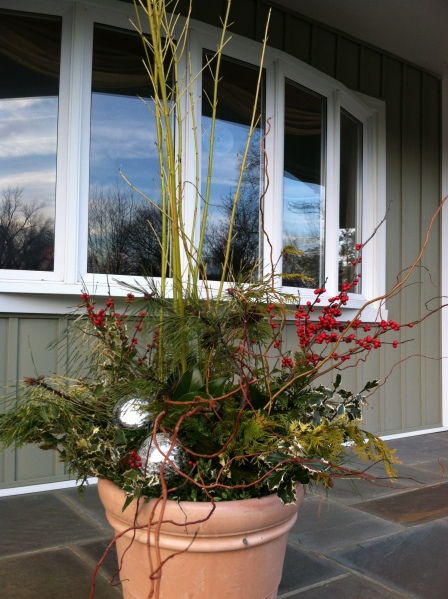 Completed green arrangement on porch