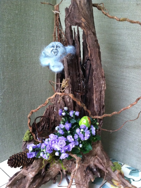 I used an old stump to make this fairy house
