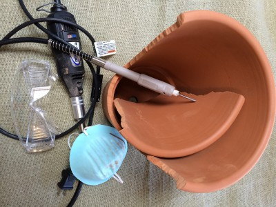 Gather materials-dremel, goggles, face mask, pot, carbide tip