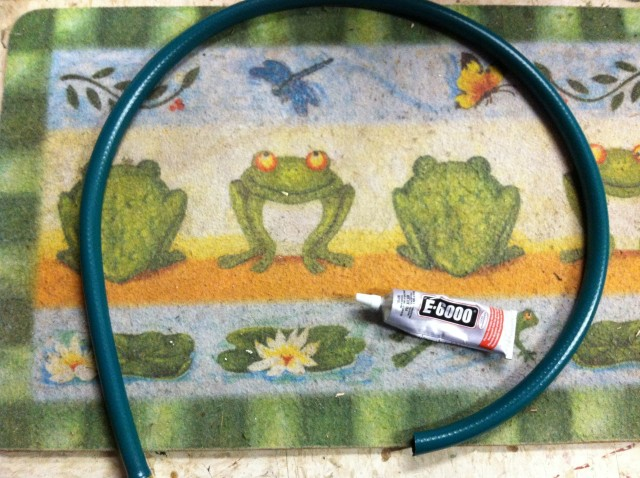 Start with an old floor mat, a piece of hose, and some E-6000 adhesive