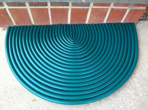 Door mat made out of cut hoses