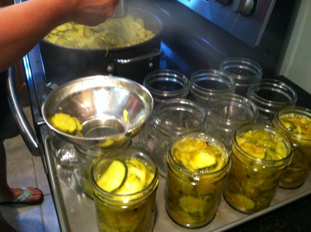 Filling the jars with hot bread and butter mixture