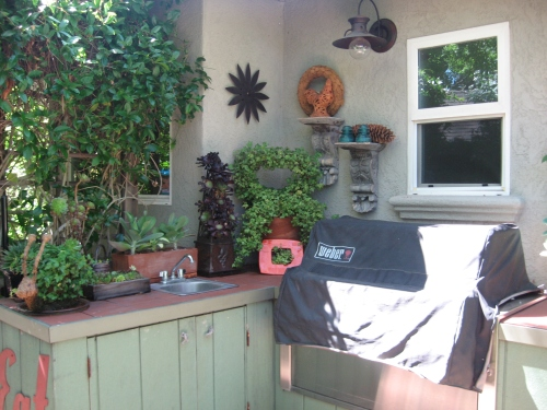The outdoor kitchen area which seems to be a requirement for California living
