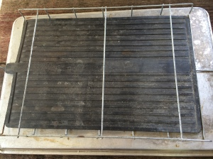 Bottom heating mat set on top of a large cookie sheet