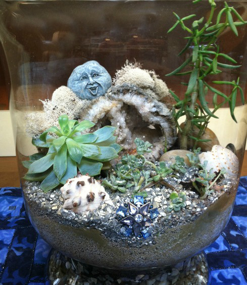 I like to use decorative rocks such as geodes and crystals in terrariums