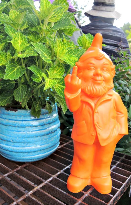 Bright orange gnome in garden