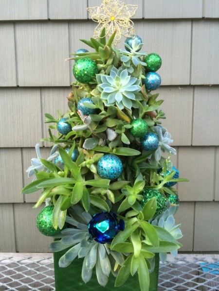 Decorate the tree with ornaments for a finishing touch