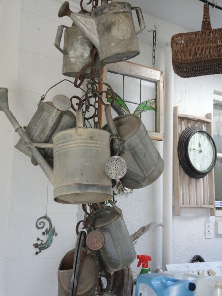Using vintage watering cans as decorations