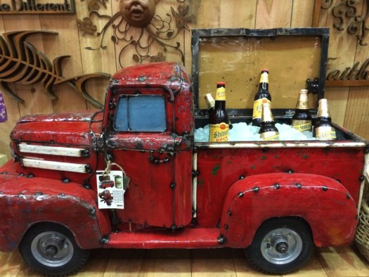 An old fire truck toy used as a cooler for drinks