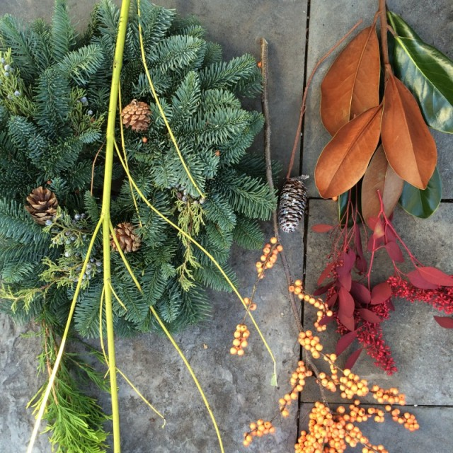 Materials-wreath, magnolia, yellow twig dogwood, winterberries, red seeded eucalyptus, glittery pine cones, yellow tipped arborvitae