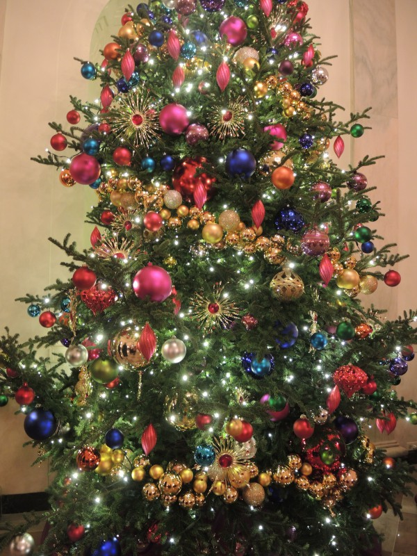 Grand Foyer trees with giant ornaments in jewel tones