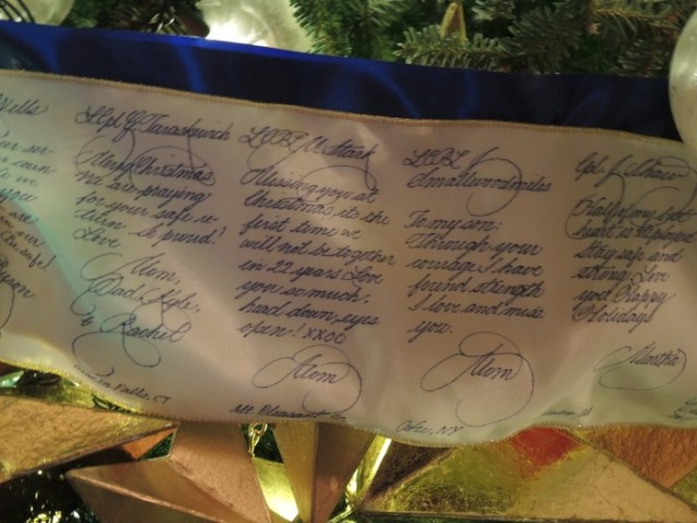 Messages were inscribed by a calligrapher on the silk garland