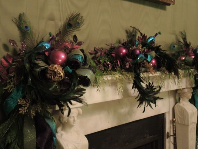 Mantel of the green room with peacocks