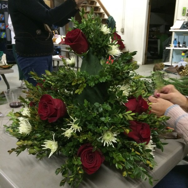 Add roses and white pom poms
