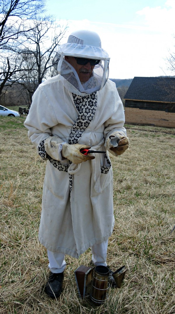 Lots of new beekeepers are entering the field. This one has a crazy suit-a bathrobe!